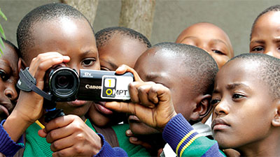 Young boys using a videocamera