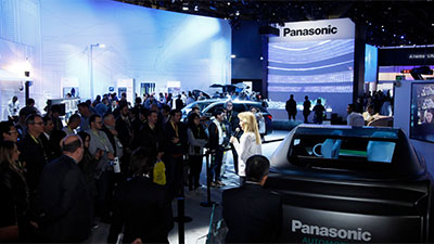 Woman on stage talking about Panasonic