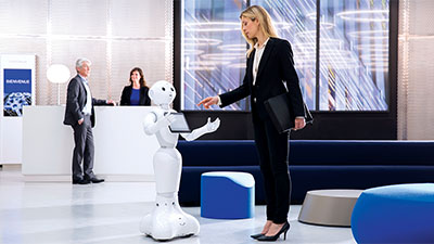 Robot and woman, interacting