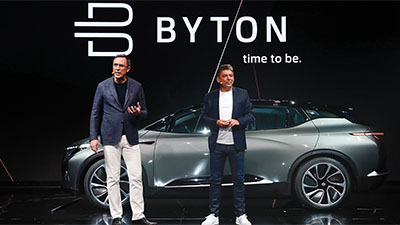 Byton car and two men standing