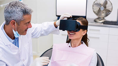 Doctor with patient using virtual reality